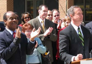 Montgomery County Executive Isiah Leggett applauds Maryland Gov. Martin O'Malley's declaration launching the Clean Energy Center.