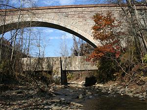 Cabin John Creek flows under the MacArthur Blvd. bridge.