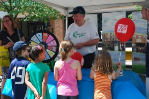 Children answer environmental questions at the Bethesda Green tent.