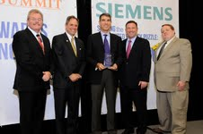 Pictured left to right: Robert Dixon, Head of Industry Affairs, Siemens Industry, Inc.; Montgomery County Councilman Roger Berliner; John Jabara, Founder of Savenia Labs; Howard County Executive Ken Ulman; and Eric Coffman, Senior Energy Planner, Montgomery County.